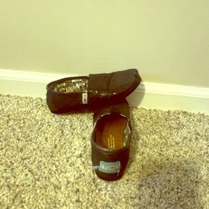 Toms little girl shoes.